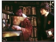"Harry Potter and the Chamber of Secrets movie still: Harry Potter (Daniel Radcliffe, right) watches as Professor Dumbledore (Richard Harris) feeds Fawkes the Phoenix in ""Harry Potter and the Chamber o"