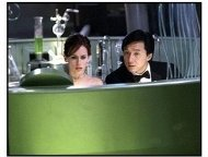 """The Tuxedo movie still: Jimmy Tong (Jackie Chan) and his rookie partner Del Blaine (Jennifer Love Hewitt) try to figure out how Banning intends to corner the market on the world's drinking water in """"T"""