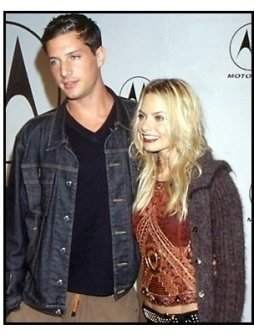 Simon Rex and Jaime Pressly at the Motorola Holiday Party