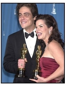 Benicio Del Toro and Marcia Gay Harden backstage at the 2001 Academy Awards