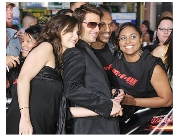Katie Holmes and Tom Cruise pose with fans