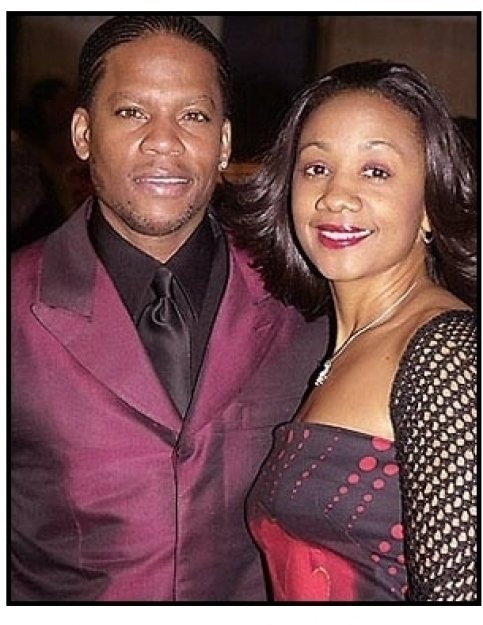 DL Hughley and wife at The Brothers premiere